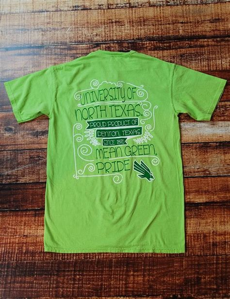 comfort mean rock this unt comfort colors t shirt this year while showing your love for the mean green dress