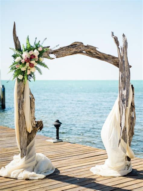 A driftwood arch is perfect for a waterfront wedding