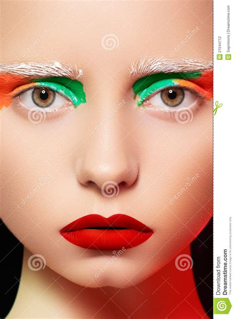 creative in make up but what we see in these hot girls wallpaper doll style model with bright creative make up stock photo