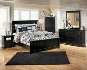 an amazing bed room with black bedroom furniture