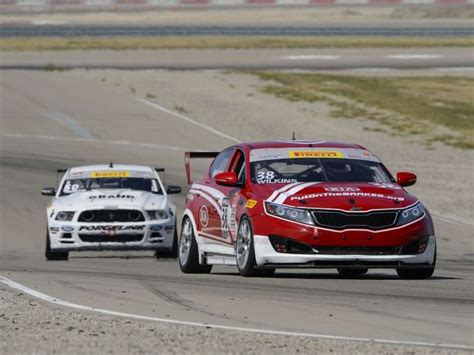Kia Optima Racing Griffin Suits Up To Support The 2015 Kia Optima