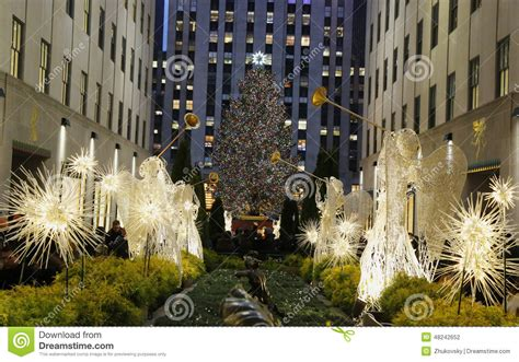 angel christmas decorations and christmas tree at the