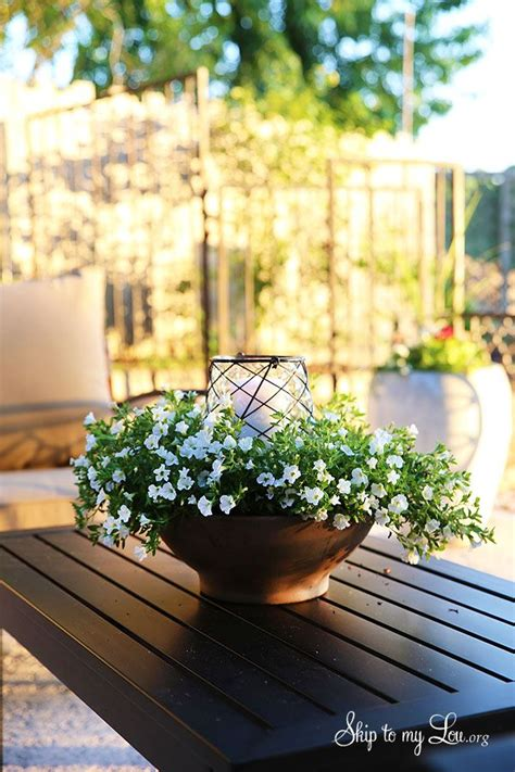 best outdoor luminaries how to make an easy floral outdoor centerpiece luminary make luminary centerpiece skiptomylou