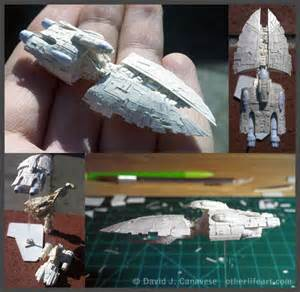 tiny star wars papercraft models fit on a fingertip