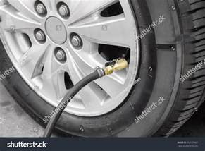 Filling Car Tires With Air Filling Air Into A Car Tire Stock Photo 252127561