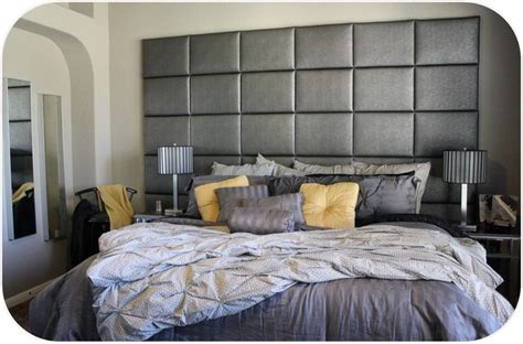 heady bed wall of upholstered panels contemporary bedroom