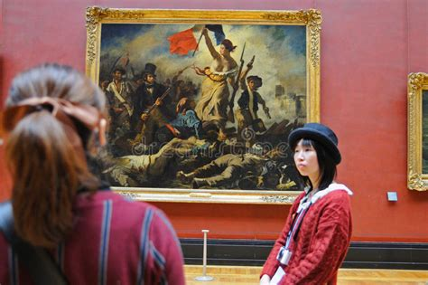 louvre paintings musee du louvre louvre museum paintings tourists look at the paintings of eugene delacroix at the louvre museum musee du louvre