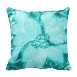 turquoise poinsettia throw pillow