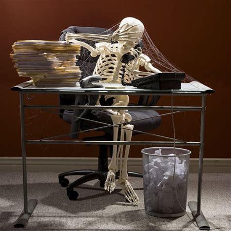 Spider Sitting At Desk by Skeleton Sitting At Desk Talking On Telephone With Webs