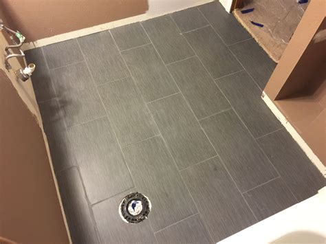 flooring   When tiling a floor must I start in the middle