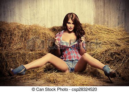 stock photo of erotic seductive young woman in jeans