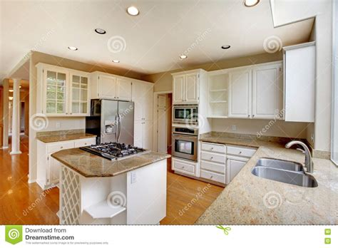 living room fridge classic american kitchen interior with white cabinets and built in stainless steel fridge stock