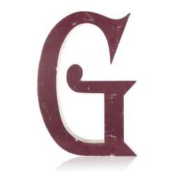 large purple letter g in a blackmoor font 171 griffin
