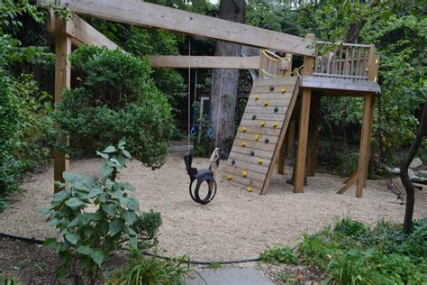 backyard climber natural playscapes pond and playground oasis in city backyard