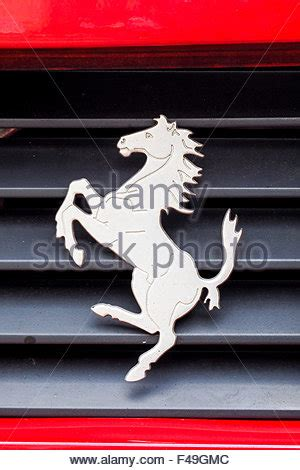 ferrari horse vs mustang horse ferrari prancing horse logo on a red racing car stock