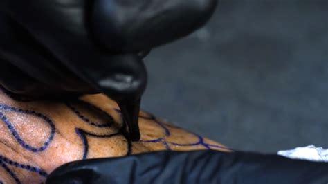 tattoo slow motion motion footage fubiz media