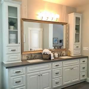 a large white vanity with sinks provides plenty of