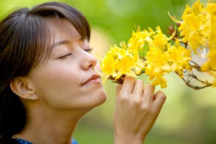 casual woman smelling flowers radical botany