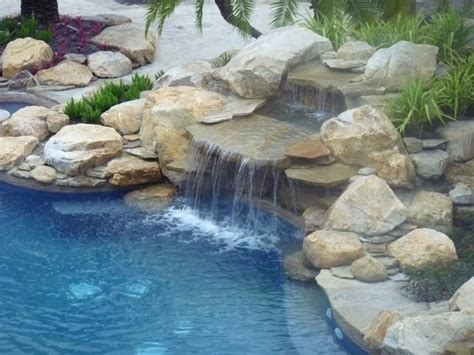 rock waterfalls for pools rock waterfall and pond into swimming pool contemporary