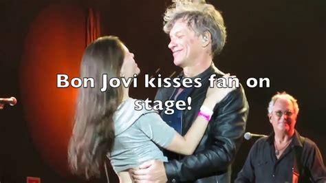 bon jovi fan bon jovi kisses fan on stage bed of roses