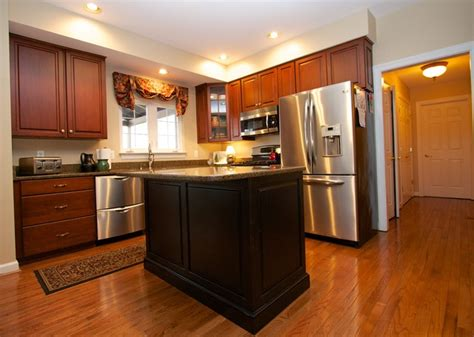 contrasting kitchen cabinets transitional cherry kitchen with contrasting island in