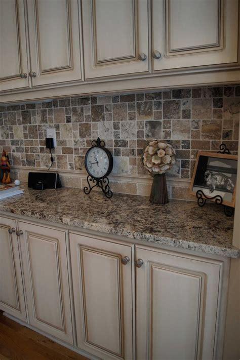 kitchen cabinets and backsplash cabinets refinished to a custom white finish with heavy glaze and oh that backsplash