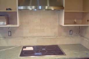 granite counter top with crema marfil subway backsplash
