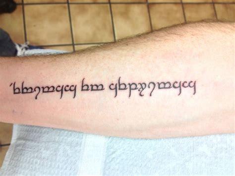 latin dictionary tattoo right forearm latin phrase quot veritas et aequitas quot written