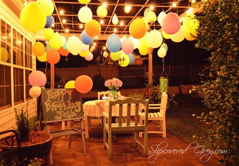 outside party outdoor movie birthday celebration slipcovered grey