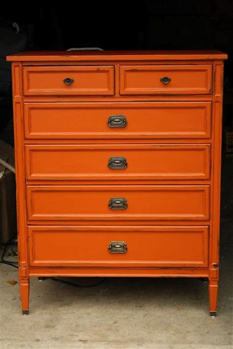 25 best ideas about orange furniture on orange painted furniture orange cupboard