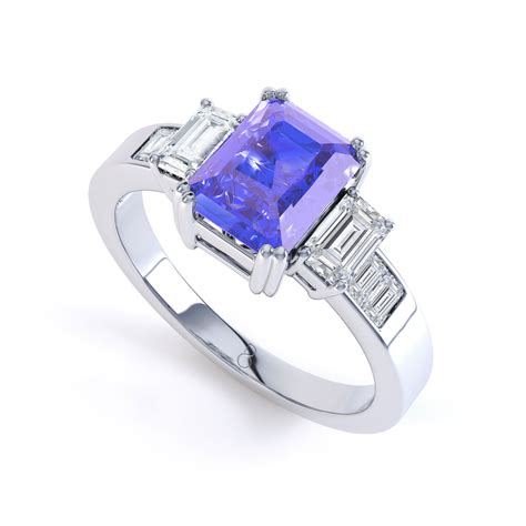 9k white gold tanzanite and engagement ring h si