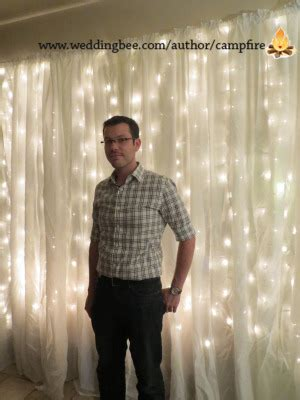 diy photo booth backdrop with string lights weddingbee
