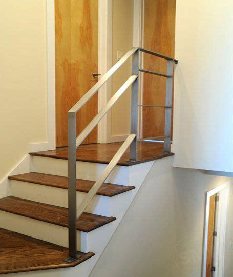 a modern flat bar stainless steel railing installed
