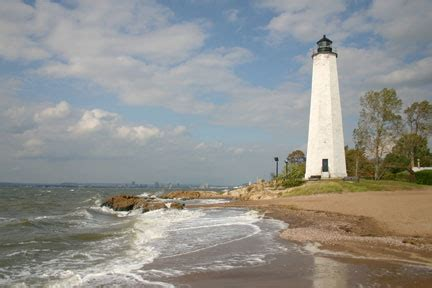 Five Mile Point Light by Fall Traffic At The Lighthouse Pathways Of The