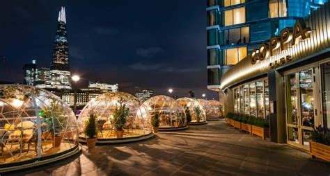 dine in a heated igloo on the banks of london s river dine in a heated igloo on the banks of london s river