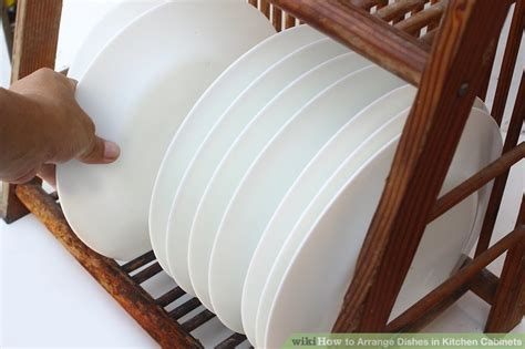 how to arrange kitchen cabinets 4 ways to arrange dishes in kitchen cabinets wikihow
