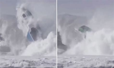 boat crash viral video watch horrifying moment giant wave crushes tiny boat in