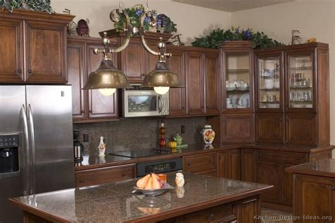 wood and glass kitchen cabinets traditional dark wood walnut kitchen cabinets 21 kitchen