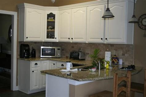 Oak Kitchen Cabinets Painted White by How To Paint Oak Kitchen Cabinets Home Furniture Design