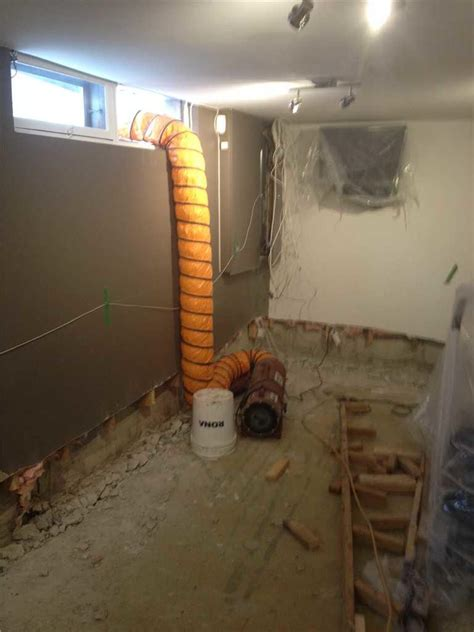 installing the interior drain to replace the french drain