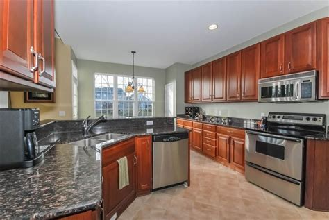 gray paint with cherry cabinets gray kitchen cherry cabinets quicua com