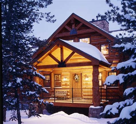snow covered cabin in the woods beautiful places and