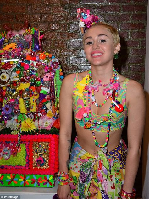 Psychedelic Ls by Miley Cyrus Debuts Hippie Installation At