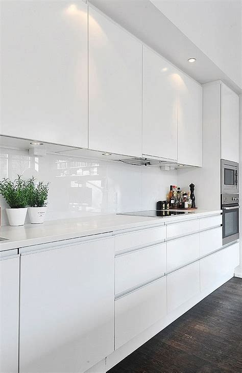 shiny white kitchen cabinets white splashback ideas