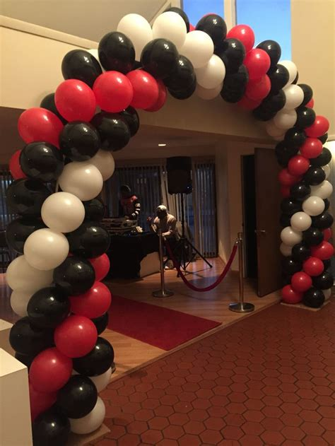 themes in black balloon super 16 red black and white spiral balloon arch