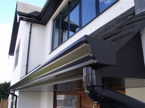 aluminum gutters installation of black fascias soffits and seamless
