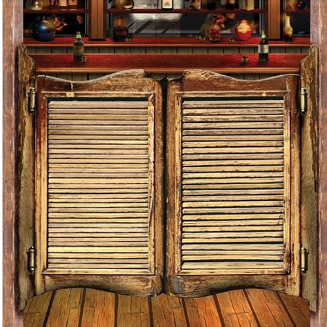 swinging doors a jukebox and a barstool old west saloons saloon doors wild west cowboy decor