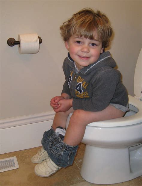 Baby And Portable Potty Seat Trainer Tempat Pipis Travel boy going potty what is a age to potty