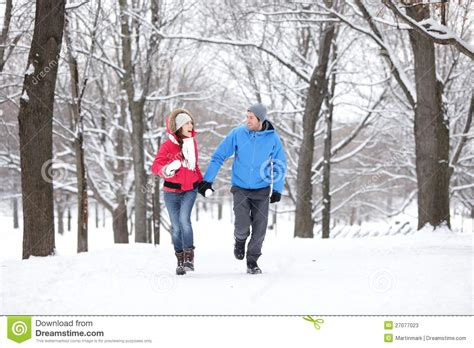 walking in a winter couple walking in winter forest stock photos image 27077023