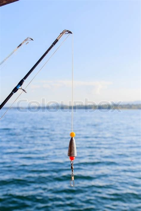 blue sky bait boats fishing rods at the ready with blue sky stock photo